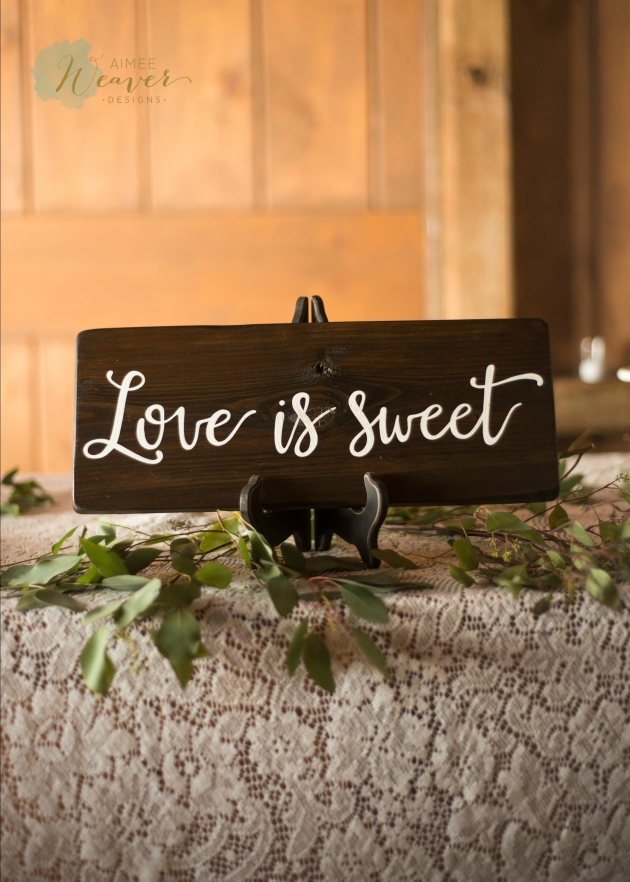 Love is sweet wood wedding cake sign Aimee Weaver Designs
