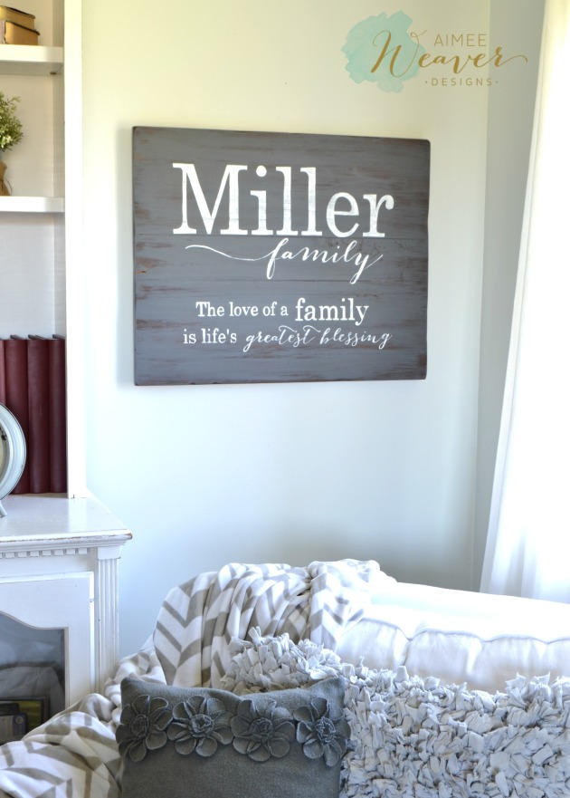 Family name sign by Aimee Weaver Designs // personalized and handmade with reclaimed barn wood